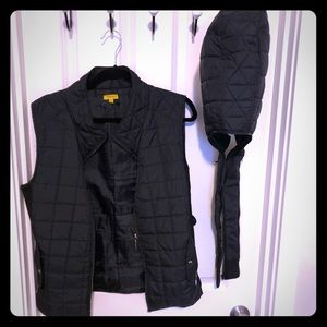 Packable quilted vest with removable hood